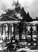 The Reichstag in flames during the Nazi ascent to power in Berlin