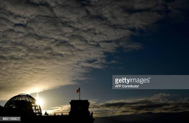 The Reichstag building seat of the Bundestag the German lower house of parliament is pictured in Berlin on September 20 2017 / AFP PHOTO / Tobias...