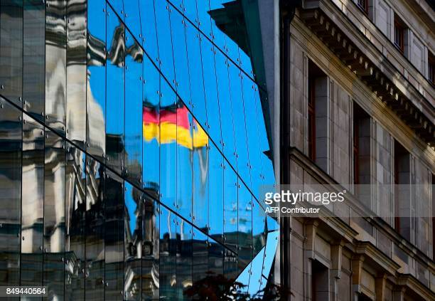 The Reichstag building seat of the German lower house of Parliament Bundestag is reflected in an glass facade in Berlin on September 19 5 days before...