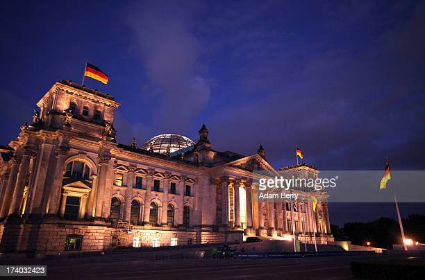 The Reichstag building seat of the national Parliament of the Federal Republic of Germany the Bundestag is shown on July 19 2013 in Berlin Germany...