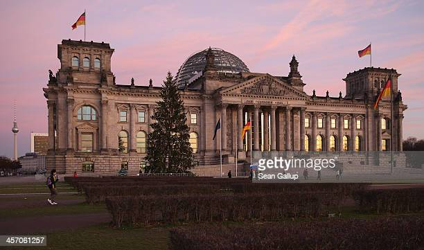 The Reichstag seat of the Bundestag stands under a twilight sky on the day Angela Merkel Chancellor and Chairwoman of the German Christian Democrats...
