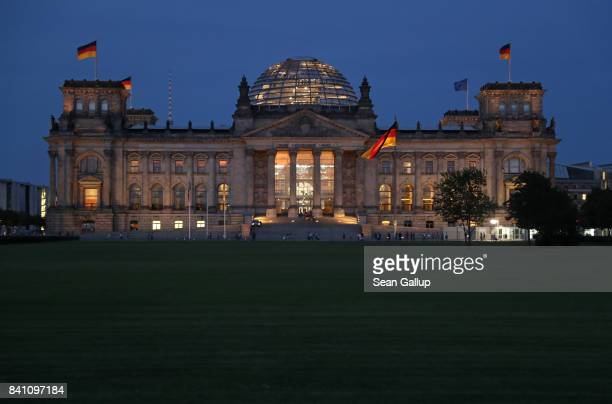 The Reichstag seat of the Bundestag the German parliament stands at twilight on August 30 2017 in Berlin Germany Germany is scheduled to hold federal...