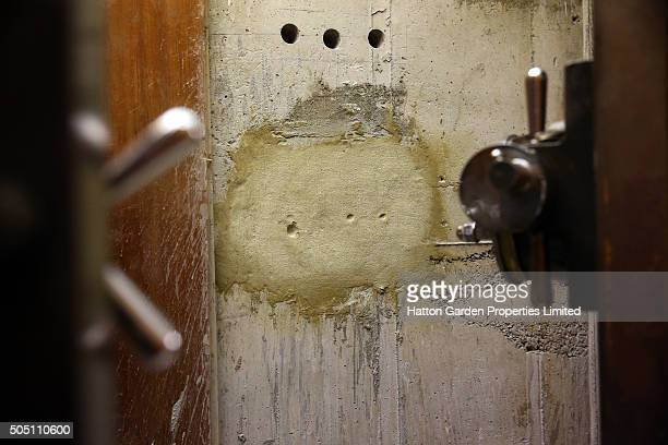 The reinforced steel door and the sealed hole that had been cut through the 50cmthick concrete wall are pictured in the underground vault of the...