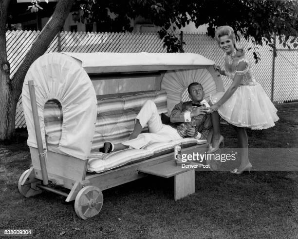 The relaxin covered wagon chaise shown here with Fred and Mickie Finn of NBC's Mickie Finn series is a rugged piece of outdoor furniture that is...