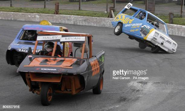 The Reliant Robin of No 12 Lyle Watson goes off the track during the Reliant Robin race at the stock car racing event at Nutts Corner Raceway in...