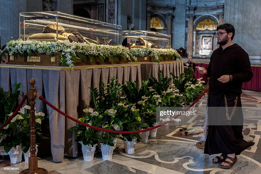 The relics of Saint Pio of Pietrelcina, better known as Padre Pio, and Saint Leopold Mandic are displayed to faithful inside St. Peter's Basilica at the Vatican. Padre Pio became famous for bearing the stigmata, which are the marks of Christ, for most of his life, thereby generating much interest and controversy. He was both beatified (1999) and canonized (2002) by Pope John Paul II.