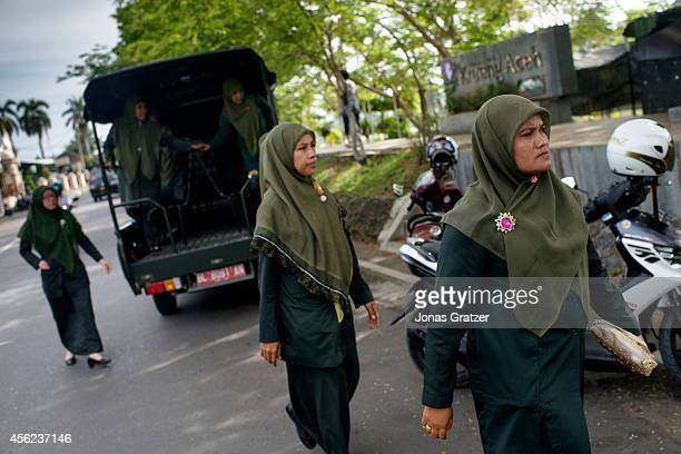 The religious Sharia Police are out on patrol in their peoplecarrier / pickuptruck to look for people who are opposing the Sharia Law In the...
