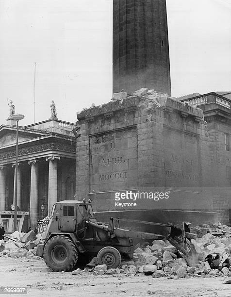 The remainder of Nelson's Pillar in the centre of O'Connell Street Dublin after it was demolished by an explosion during the 50th anniversary year of...
