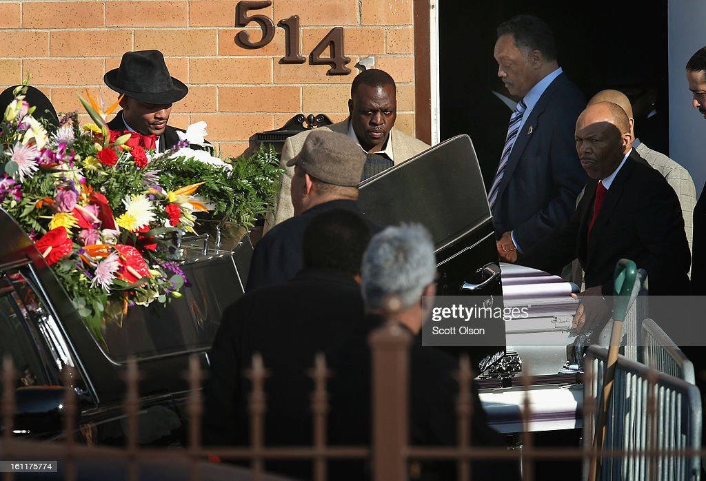 The remains of 15-year-old Hadiya Pendleton are carried from the Greater Harvest M.B. Church following her funeral on February 9, 2013, in Chicago, Illinois. Hadiya was killed on January 29, when a gunman opened fire on her and some friends while they were standing under a shelter on a warm rainy afternoon in a park about a mile from President Obama's Chicago home. First lady Michelle Obama attended the funeral with Senior White House Adviser Valerie Jarrett and Secretary of Education Arne Duncan.