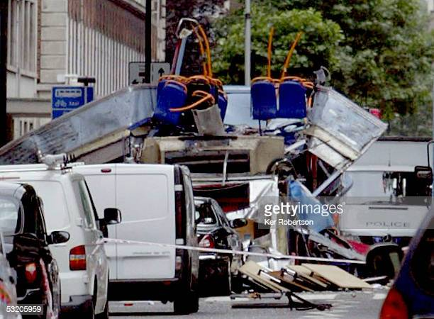 The remains of a bus are seen on Tavistock Square following a series of explosions which ripped through London's underground tube and bus network on...