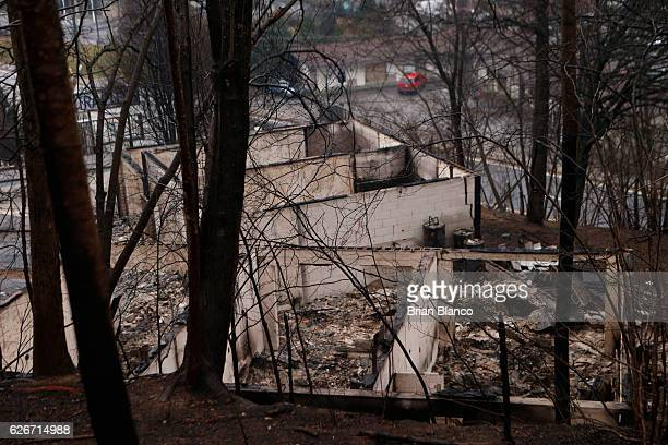 The remains of a business smolders in the wake of a wildfire November 30 2016 in Gatlinburg Tennessee Thousands of people have been evacuated from...