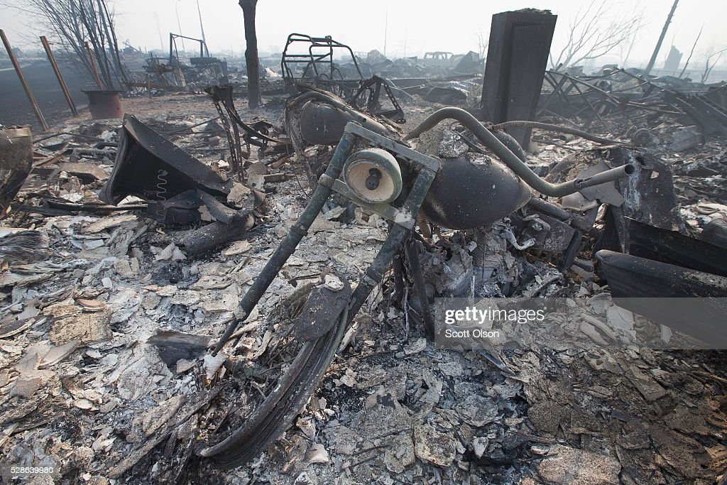 The remains of a charred motorcycle sit in a residential neighborhood destroyed by a wildfire on May 6, 2016 in Fort McMurray, Alberta, Canada Wildfires, which are still burning out of control, have forced the evacuation of more than 80,000 residents from the town.