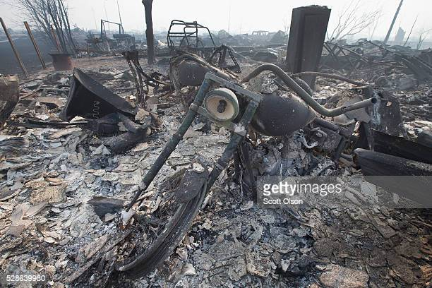 The remains of a charred motorcycle sit in a residential neighborhood destroyed by a wildfire on May 6 2016 in Fort McMurray Alberta Canada Wildfires...
