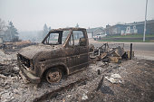 The remains of a charred vehicle sit in a residential neighborhood heavily damages by a wildfire on May 7 2016 in Fort McMurray Alberta Canada...