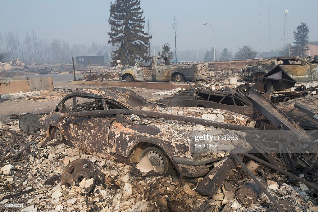 The remains of a classic Triumph GT6 sit in a residential neighborhood destroyed by a wildfire on May 6, 2016 in Fort McMurray, Alberta, Canada Wildfires, which are still burning out of control, have forced the evacuation of more than 80,000 residents from the town.