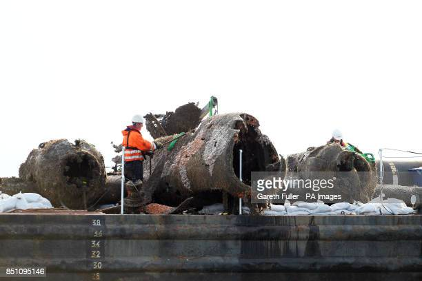 The remains of a crashed World War II Dornier bomber the only surviving German Second World War Dornier Do 17 bomber rests on a barge after being...