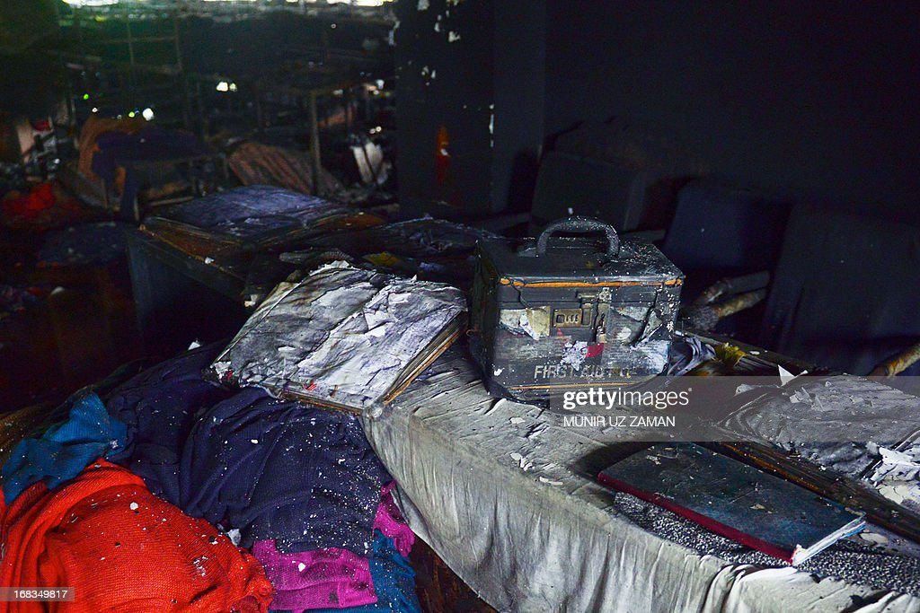 The remains of a first aid box is seen inside a gutted garment factory in Dhaka on May 9, 2013. A fire at a garment factory killed at least eight people May 9 in the latest disaster to hit Bangladesh's textile industry, still reeling from the deaths of more than 900 people in a building collapse. AFP PHOTO/Munir uz ZAMAN