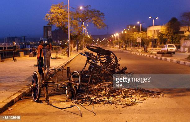 The remains of a horse carriage lies on the street in the southern Egyptian city of Aswan on April 6 2014 following tribal clashes which killed at...