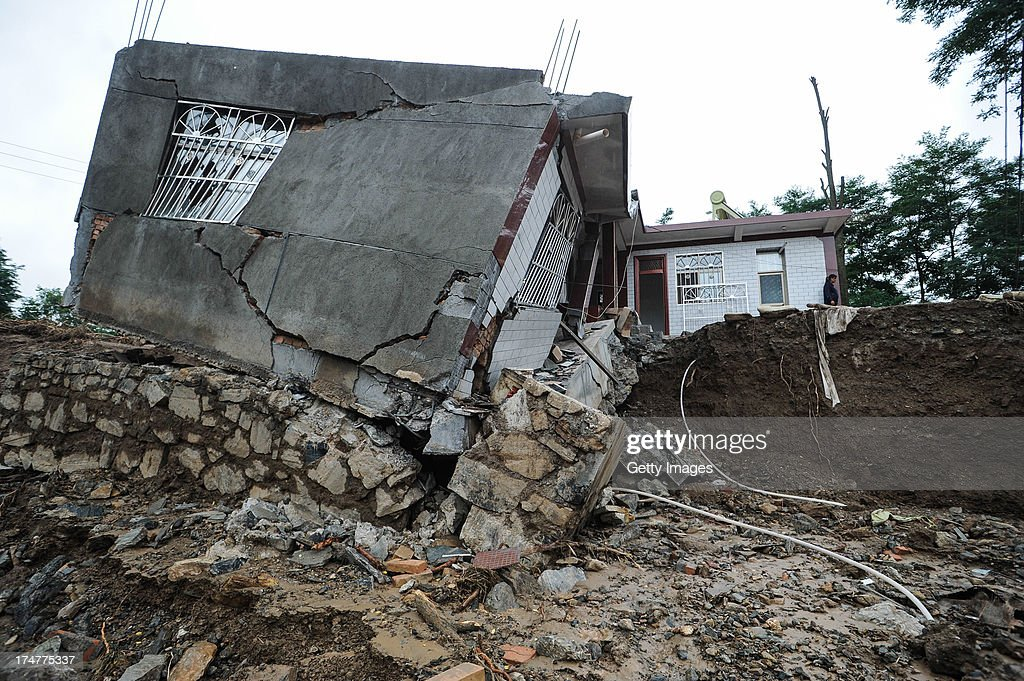 The remains of a house destroyed by landslides is seen on July 28, 2013 in Tianshui, China. At least 22 people were killed and three others missing after rainstorm-triggered floods and landslides hit many places of Tianshui city recently.