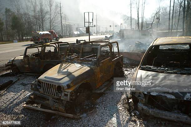 The remains of a Jeep rental business smolders after a wildfire November 29 2016 in Gatlinburg Tennessee Thousands of people have been evacuated from...