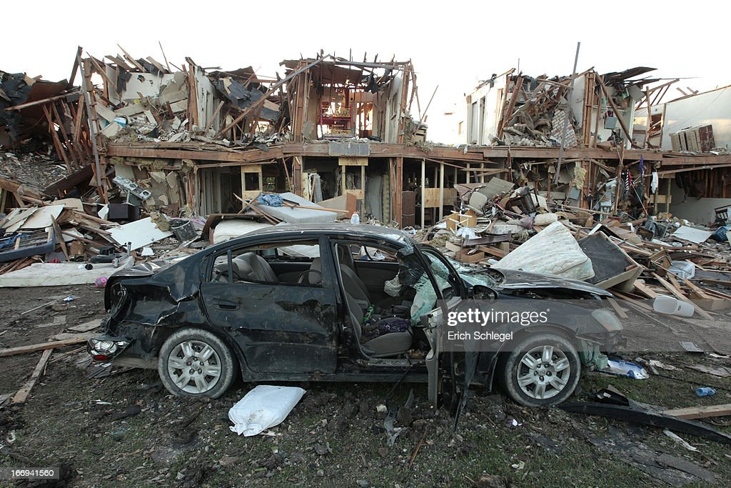 The remains of an apartment complex and a destroyed car lies in ruins next to the fertilizer plant that exploded yesterday afternoon on April 18, 2013 in West, Texas. According to West Mayor Tommy Muska, around 14 people, including 10 first responders, were killed and more than 150 people were injured when the fertilizer company caught fire and exploded, leaving damaged buildings for blocks in every direction.