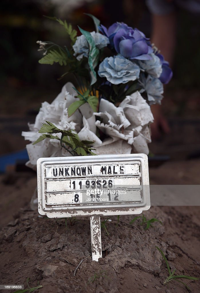 The remains of an unidentified immigrant await exhumation from a cemetery on May 21 2013 in Falfurrias Texas Teams from Baylor University and the...