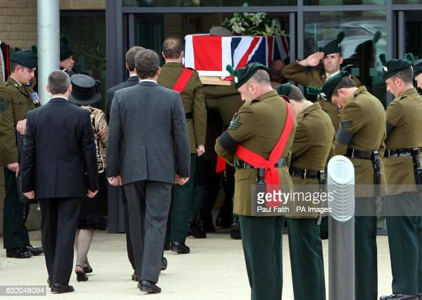 The remains of Captain David Patten are removed for a funeral service at Portstewart Baptist church Co Antrim after the Ulster soldier was killed as...