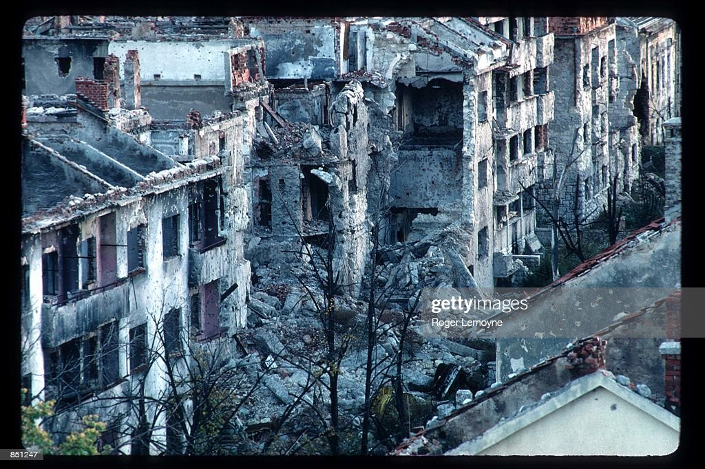The remains of destroyed buildings stand on the frontline December 1 1994 in Mostar BosniaHerzegovina When Bosnia declared its independence in March...