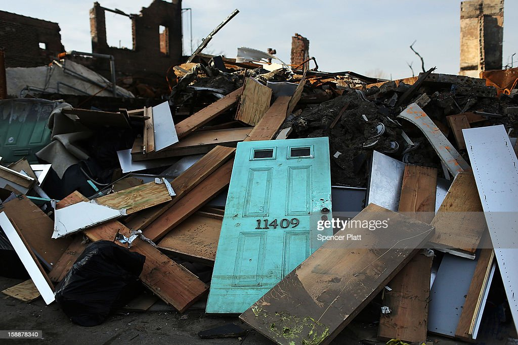 The remains of destroyed homes and businesses are viewed after Superstorm Sandy in the Rockaways on January 2, 2013 in the Queens borough of New York City. Criticism, including by President Barack Obama, has been directed at the Republican House's decision to adjourn without passing a Superstorm Sandy aid bill. According to early estimates, Superstorm Sandy inflicted at least $50 to $60 billion in damage across the Northeast, making it one of the most destructive storms ever.
