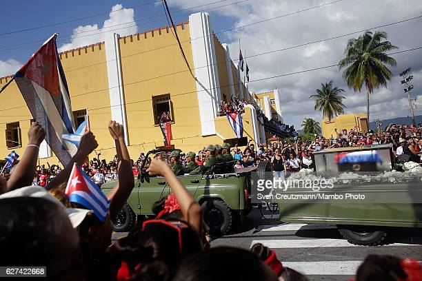 The remains of former Cuban President Fidel Castro pass by the Moncada Barracks on their fourday journey across the country December 3 2016 in...