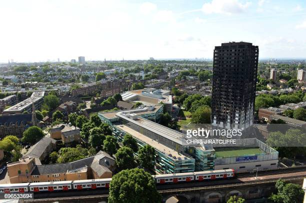 The remains of Grenfell Tower a residential tower block in west London which was gutted by fire are pictured against the London skyline on June 16...