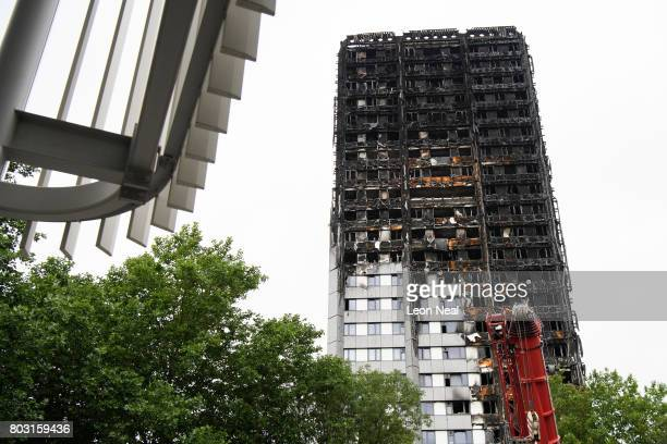 The remains of Grenfell Tower are seen on the day of the funeral of one of the victims of the fire on June 29 2017 in London England Tony Disson died...