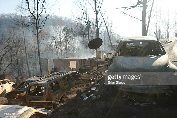 The remains of homes and vehicles smolder after a wildfire November 29 2016 in Gatlinburg Tennessee Thousands of people have been evacuated from the...