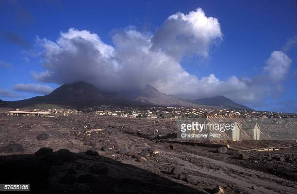 The remains of Monserrat's oldest standing building mostly submerged by mud flows rocks and ash 10 years ago the SoufriereHills Volcano erupted and...
