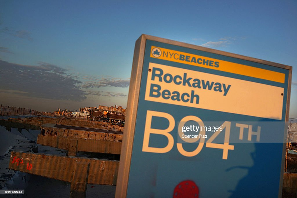 The remains of part of the boardwalk stand at Rockaway Beach following the devastation of Hurricane Sandy which destroyed large parts of the...