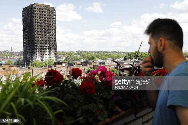 TOPSHOT The remains of residential tower block Grenfell Tower are seen from Dixon House a nearby tower block in west London on June 15 a day after it...