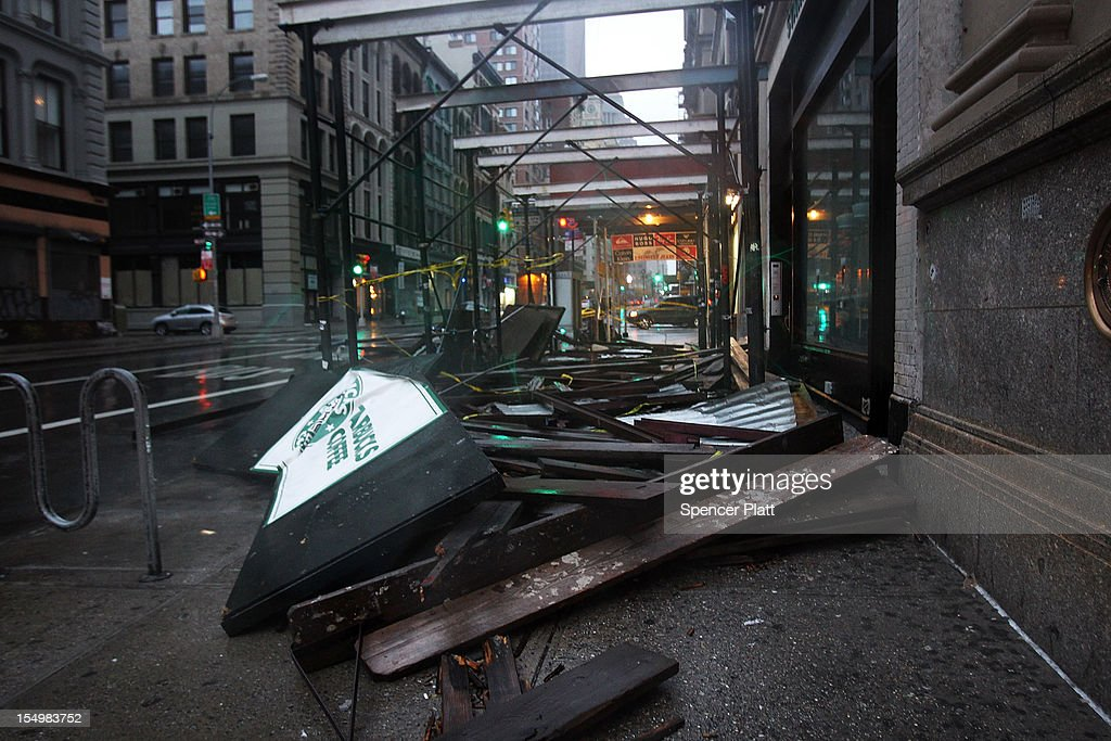 The remains of scaffolding from above a Starbucks lies on the ground in lower Manhattan as Hurricane Sandy begins to affect the area on October 29, 2012 in New York City. The storm, which threatens 50 million people in the eastern third of the U.S., is expected to bring days of rain, high winds and possibly heavy snow. New York Governor Andrew Cuomo announced the closure of all New York City bus, subway and commuter rail service as of Sunday evening.