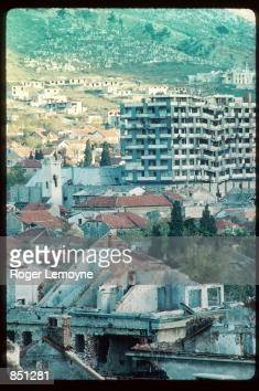 The remains of several destroyed buildings stand December 1 1994 in Mostar BosniaHerzegovina When Bosnia declared its independence in March of 1992...