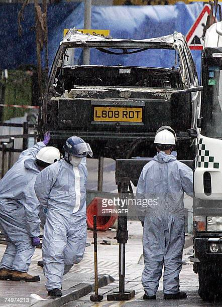 The remain's of the burnt out jeep is lifted from the scene at Glasgow International Airport01 July 2007 where a Jeep Cherokee rammed and burst into...