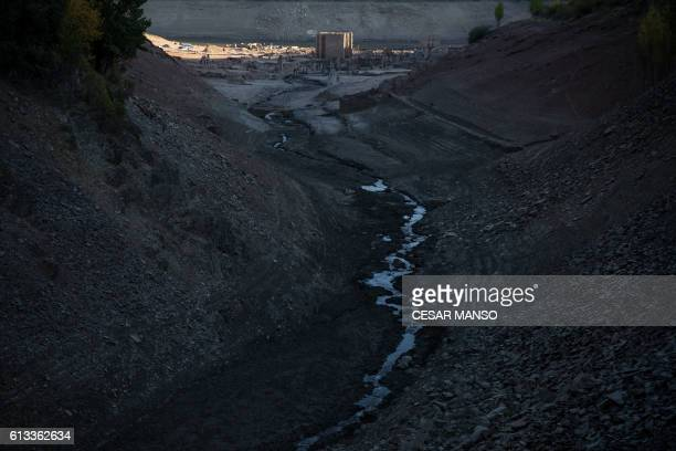 The remains of the former town of Mansilla are pictured on October 8 2016 after the village emerged from the depths of the Mansilla Reservoir as the...