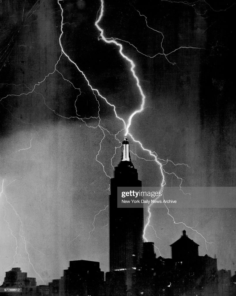 The remarkable picture, reproduced above without any retouching, was made from windows of The News last night by a staff photographer. The flash of lightening that plays around Empire State Building so closely that it seem to have hit it, provided all the light that was needed to make the picture.