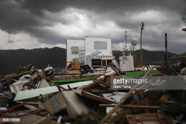 The remnants of a destroyed home stand more than two weeks after Hurricane Maria hit the island on October 6 2017 in Morovis Puerto Rico Less than 11...