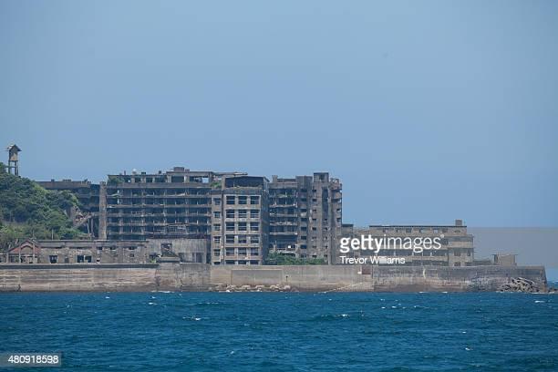 The remnants of Hashima's massive block of residential apartments and full sized hospital on July 16 2015 in Nagasaki Japan Hashima aka Battleship...