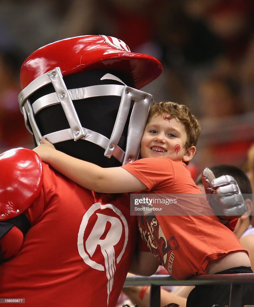 The Renegades mascot is hugged by a fan during the Big Bash League match between the Melbourne Renegades and the Hobart Hurricanes at Etihad Stadium on December 19, 2012 in Melbourne, Australia.