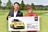 the representative Director President CEO at MercedesBenz Japan Kintaro Ueno and Nobuko Kizawa of Japan pose with the trophy after winning the LPGA...