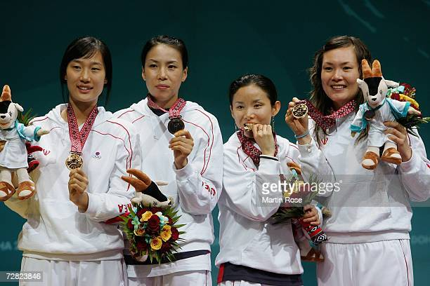 The Republic of Korea team celebrate their victory over China with their Gold Medals in the Women's Team Foil Gold Medal match during the 15th Asian...