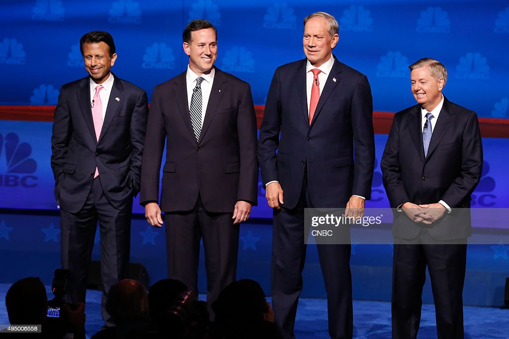 EVENTS -- The Republican Presidential Debate: Your Money, Your Vote -- Pictured: (l-r) <a gi-track='captionPersonalityLinkClicked' href=/galleries/search?phrase=Bobby+Jindal&family=editorial&specificpeople=2249969 ng-click='$event.stopPropagation()'>Bobby Jindal</a>, <a gi-track='captionPersonalityLinkClicked' href=/galleries/search?phrase=Rick+Santorum&family=editorial&specificpeople=212911 ng-click='$event.stopPropagation()'>Rick Santorum</a>, <a gi-track='captionPersonalityLinkClicked' href=/galleries/search?phrase=George+Pataki&family=editorial&specificpeople=202813 ng-click='$event.stopPropagation()'>George Pataki</a> and <a gi-track='captionPersonalityLinkClicked' href=/galleries/search?phrase=Lindsey+Graham&family=editorial&specificpeople=240214 ng-click='$event.stopPropagation()'>Lindsey Graham</a> participate in CNBC's 'Your Money, Your Vote: The Republican Presidential Debate' live from the University of Colorado Boulder in Boulder, Colorado Wednesday, October 28th at 6PM ET / 8PM ET --