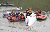 The rescue crew pulls out a passenger from a TransAsia Airways ATR 72600 turboprop airplane that crashed into the Keelung River shortly after takeoff...