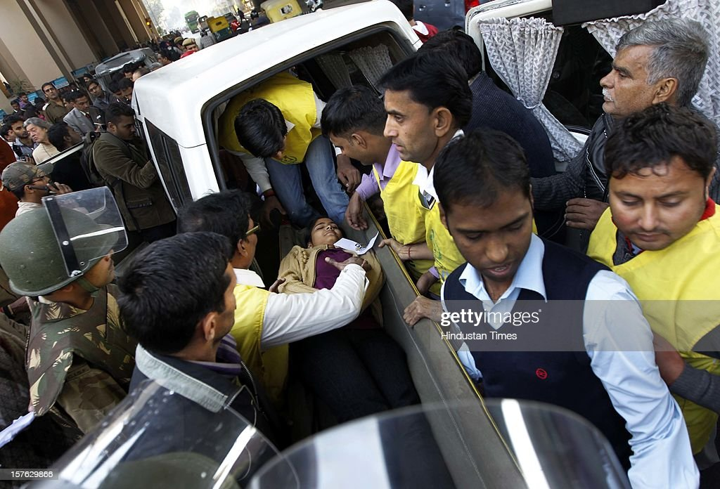 The rescue team carrying out a woman pretend to be injured during a mock drill session at the Jhandewalan Metro station on December 4, 2012 in New Delhi, India. A mock drill held in the capital under which simulated situations was created across the city to check medical response system of prominent hospitals in the city in the event of an earthquake, fire and bomb blasts.