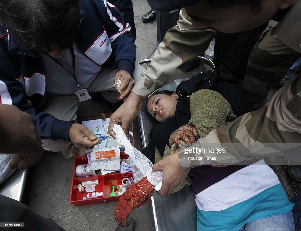 The rescue team giving the first aid to a woman pretend to be injured during a mock drill session at the Jhandewalan Metro station on December 4, 2012 in New Delhi, India. A mock drill held in the capital under which simulated situations was created across the city to check medical response system of prominent hospitals in the city in the event of an earthquake, fire and bomb blasts.